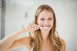 woman brushing teeth 675239882 21Dec2020