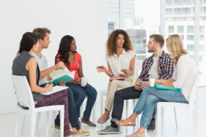 The company staff sitting in a casual room engaged in a discussion